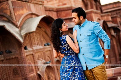 Dressed in blue coordinated ethnic outfits for their destination pre wedding photo shoot at Jodhpur