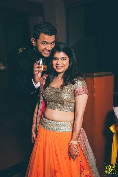 Rupa wearing gold and orange legenga with heavily gold embroidered choli and keeping it simple with no jewellery and light makeup.