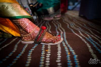 Bridal feet mehndi photography of the wedding shoes and mehndi design