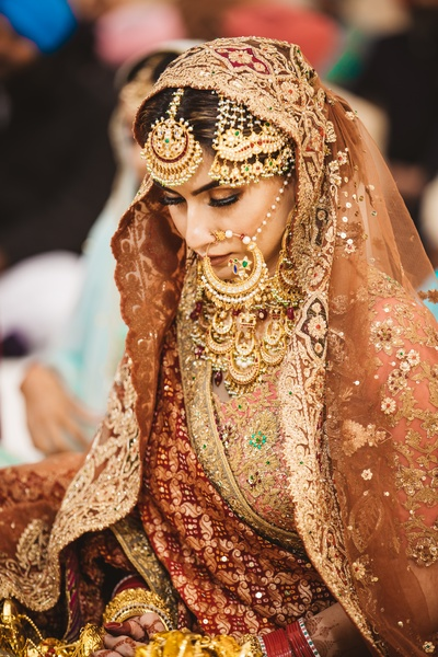 We are swooning over the bride's unconventional choice of lehenga colour and jewellery designs
