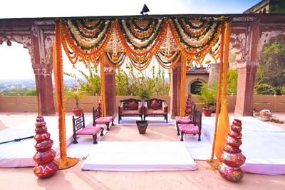 Simple vedi mandap with Marigold strings and ascending pottery arrangement