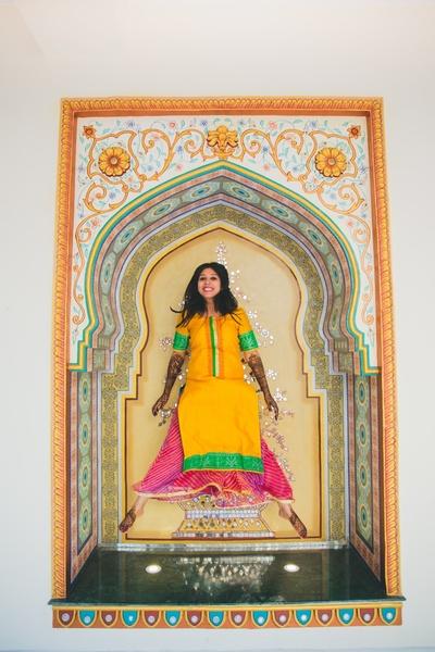 Wearing yellow kurti coordinated with beautiful pink bandhani palazzo pants for the mehndi ceremony.