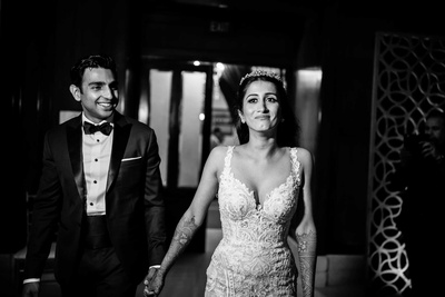 Bride and groom entering their sangeet function together