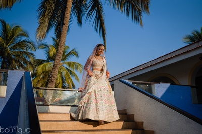 the bride decked in a pastel lehenga for her wedding
