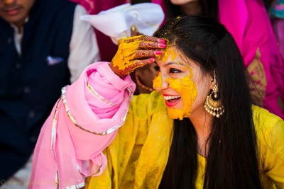 Dressed in a yellow punjabi suit and drop chand bali earrings for the beach side chooda ceremony held at Goa Marriott
