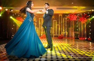 The couple dancing and having a gala time at their sangeet ceremony.