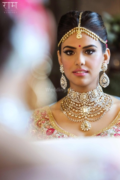 Bride Anushka Rajan gets ready for the wedding ceremony in her statement diamond and polki jewellery set