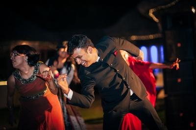 Black jodhpuri bandhgala royal suit styled with red silk pocket square