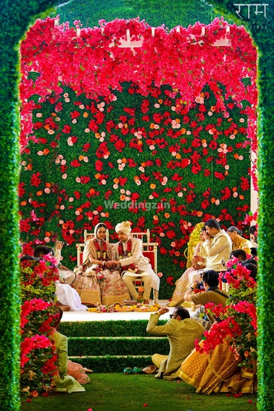 Ceremonial wedding photography of the bride and groom at the floral mandap