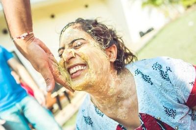 Pretty and happy bride having fun at her Haldi Ceremony held at Radisson Blu Alibaug
