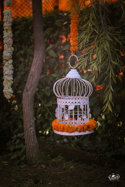 Gorgeous white cage decor with marigold flowers for mehndi decor