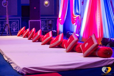 Gaddas and bolsters arrangement for the Sangeet ceremony at Hotel Fairmont, Jaipur