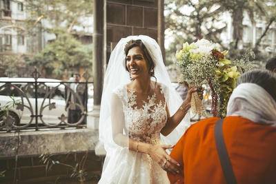 A smiling candid of the bride