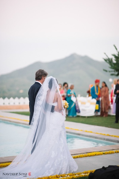 White trailed laced wedding gown with sheer embroidered veil