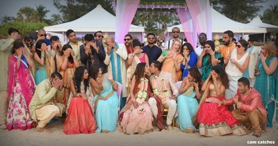candid photography of the bride and groom with family