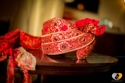 Red Safa with gold textures embellished with stone work