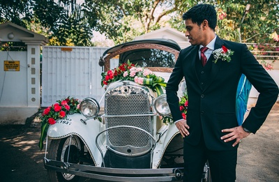 White vintage car decorated with fresh flower bouquets