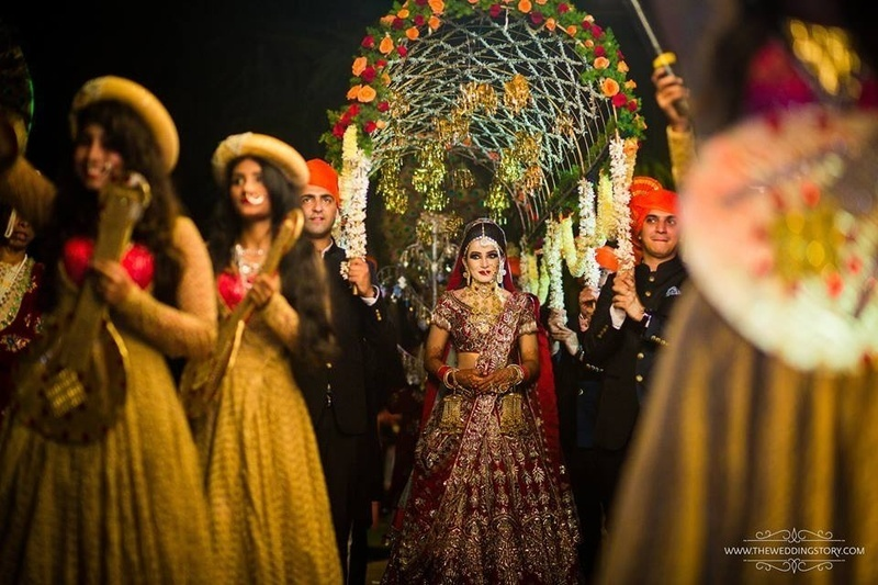 5. A semi dome shaped chadaar with flowers and tassels