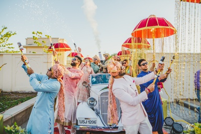 Bride and Groom enter the wedding with a bang in a vintage car, giving us major entry ideas