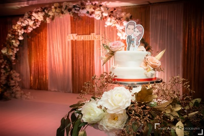 A close-up shot of the couple's cute floral wedding cake.