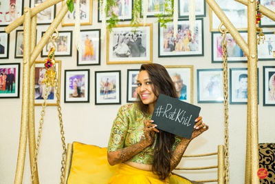 Bride poses with a signboard of the wedding hashtag