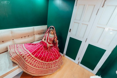 Vishakha in her beautiful bridal red lehenga.