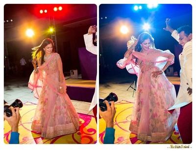 Floral blush pink layered anarkali lehenga for the sangeet ceremony styled with minimum diamond jewellery