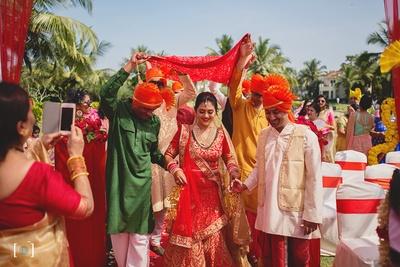 Bridal entry under the phoolon ki chaddar wearing her Meena Bazaar lehenga and jewellery from Sajni