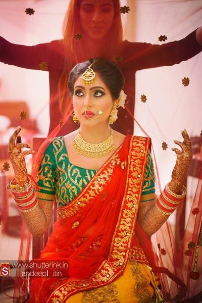Mix-matched designer wedding lehenga set heavily embellished with gold zari work