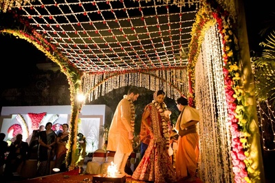 Attractive arrangement of the Vedi mandap using red and yellow Roses and Tube Roses