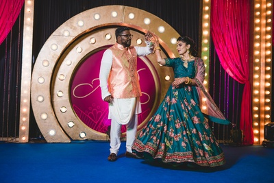 The couple performing at their sangeet ceremony.