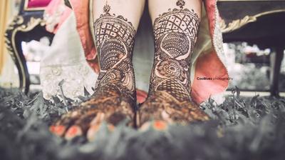 Bridal feet adorned with beautiful mehendi design