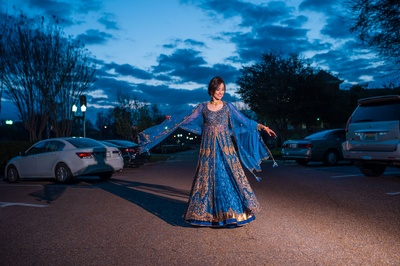 In love with this bride twirling in her blue anarkali!