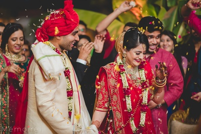 A candid shot of bride and groom taking pheras