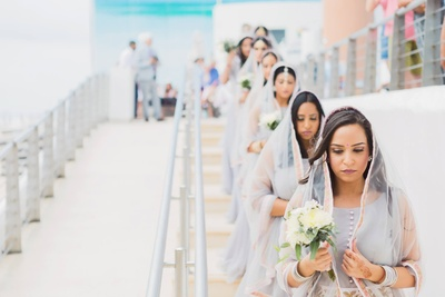 Bridal entry begins with the bridemaids in matching attire