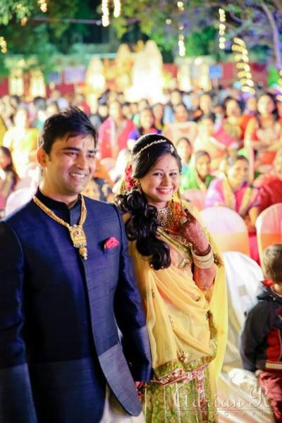 Deep blue bandhgala nehru jacket adorned with a gold men's necklace