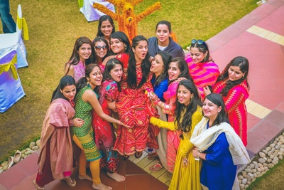 Bride and the bridesmaids all colorfully dressed in ethnic outfits.