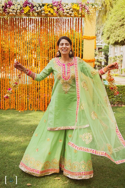 Wearing mint green kurti and palazzo with gota patti work styled with minimal jewellery for the Kaleere ceremony held at Jehanuma palace lawns, Bhopal.