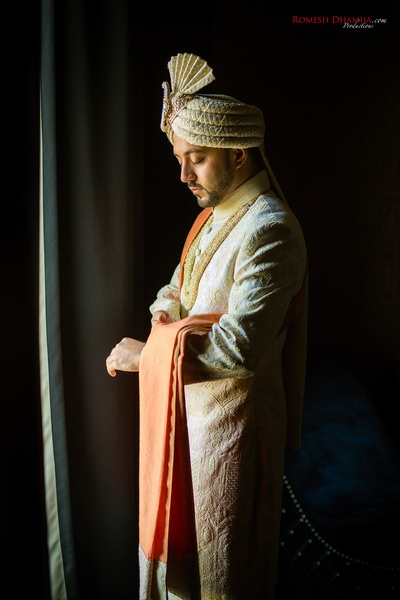 Candid shot of the groom getting ready before the wedding function