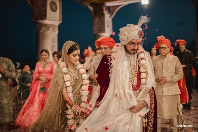 The bride and groom taking pheras during the wedding ceremony.