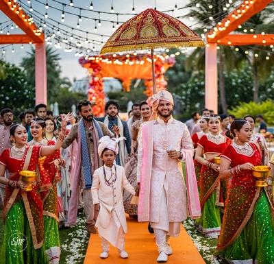 the groom making his way to the mandap in pale pink sherwani