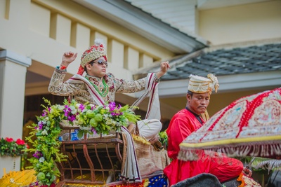 Groom donning a beige embroidered sherwani for the royal wedding ceremony held in Sofitel, Krabi