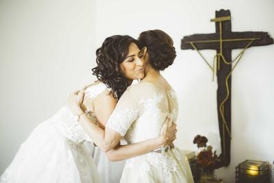 The bride hugging her mother