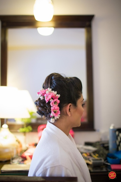 bridal hair do with natural flowers in pink and white