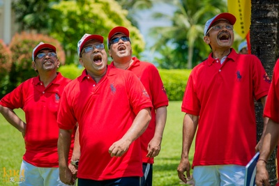 Dressed in customized red Polo T-shirts for the cricket match