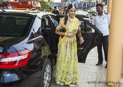 Yellow lehenga choli featuring sheer lining embroidered with floral design with metallic underskirt