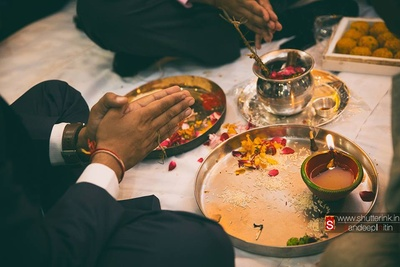 Pooja ceremony, with diya flower petals, rice grains and Tulsi