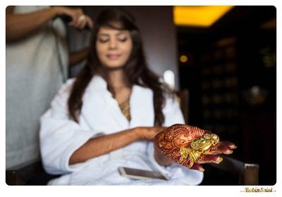 Gold heirloom drop jhumkas studded with kundan, emeralds and rubies
