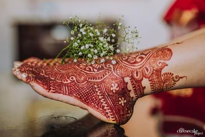 intricate mehendi design for feet