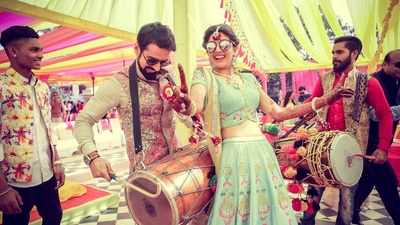 Bride and groom dancing together during their mehndi function